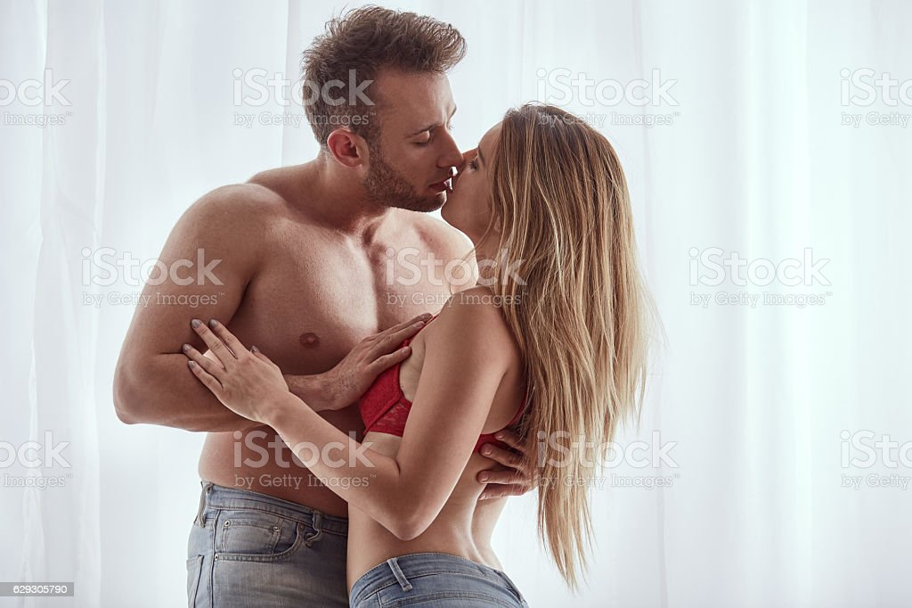 Man and womankissing nakedly